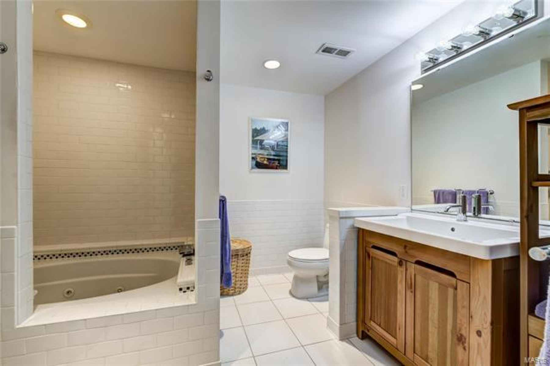 Family room and 4th bedroom lead to full bath with jacuzzi tub/shower!