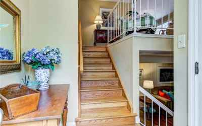 Entry foyer (with skylights) leads to main level living area as well as the family room just a few steps away
