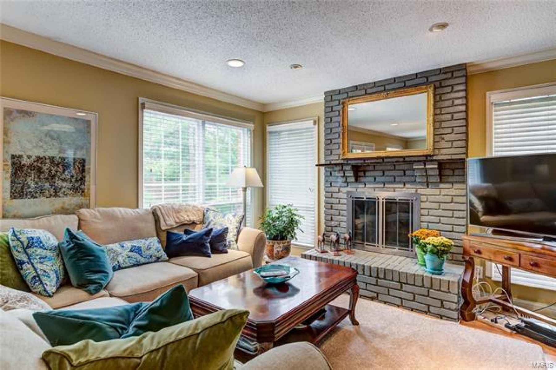 Another view of the living room with fireplace.  Stunning!