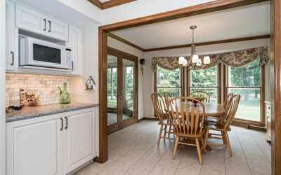 Breakfast room has bay window view of flat useful private yard, conveniently adjacent to 4 season room.