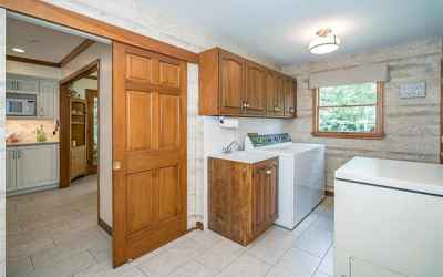 LAUNDRY TOWARDS KITCHEN, easily closed off with clever 6 panel barn door.  Extra coat closet and room for refrigerator, Freezer &/or Locker bay, and Utility sink.