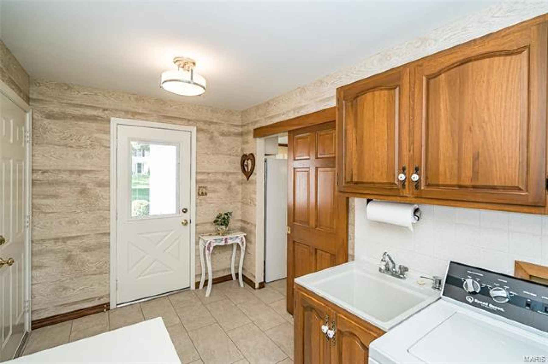 Second front door is one of the best features.  Just walks you into the BEAUTIFUL & large main floor Laundry & Utility room, and exit to over-sized 2 car garage.