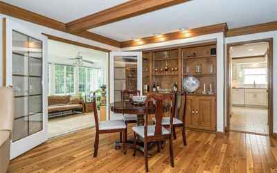 Let the sunshine in! Family room with lots of space. Wonderful for entertaining,.
