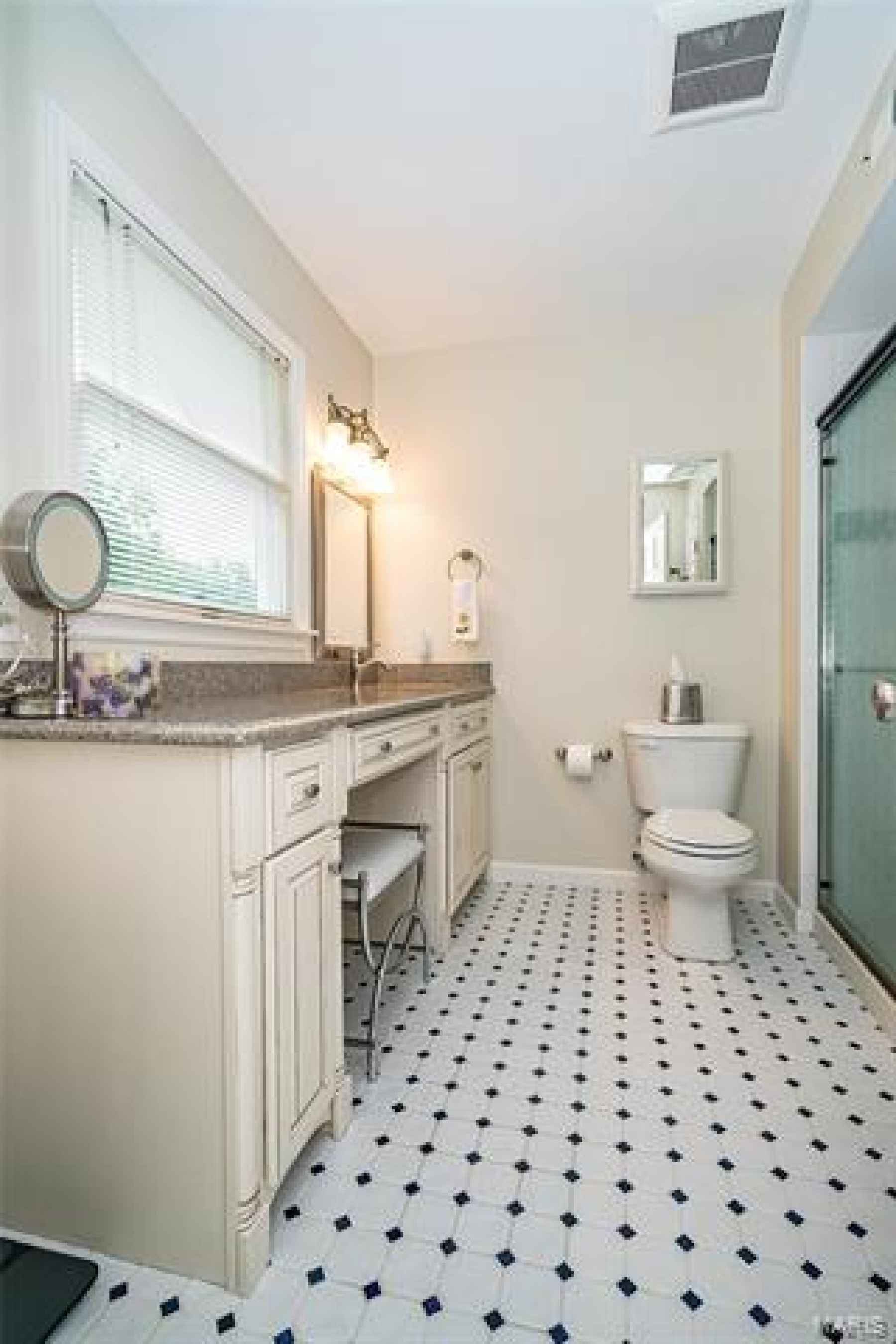Updated Master Bath with Quartz counter top , multi shower-head, roomy linen closet with pull outs.