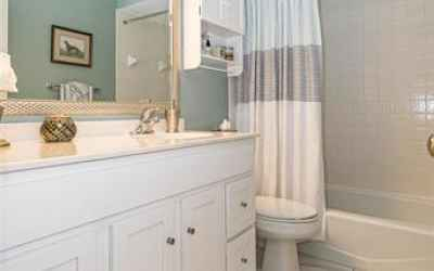 Newer Hall bathroom with beautiful porcelain tile & great amenities.