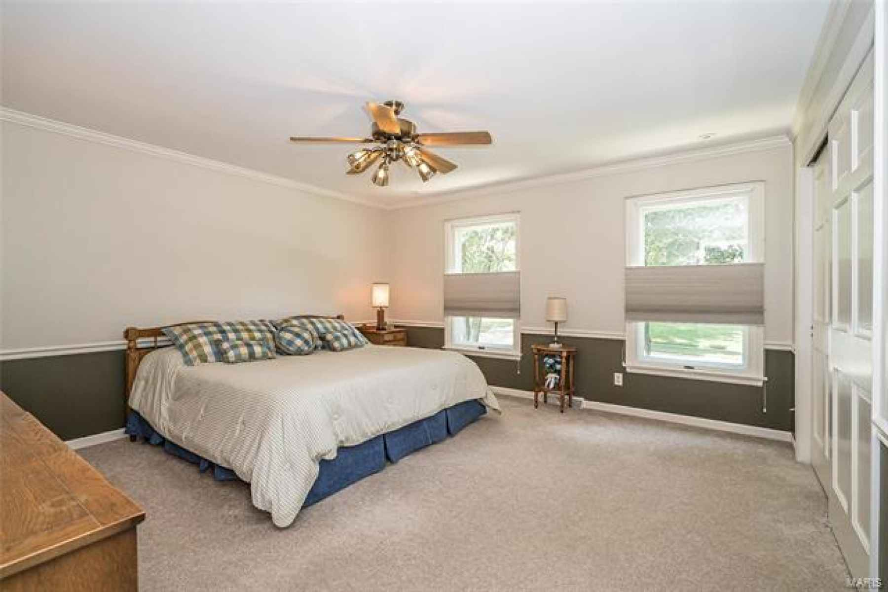 Large Bedroom with fan and built-in closet organizer
