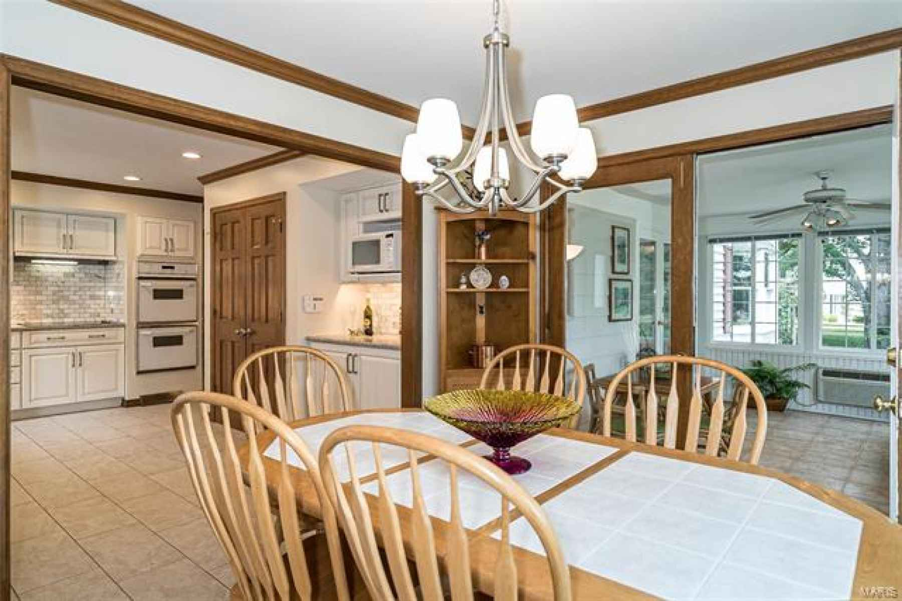 Fantastic view of Kitchen to Sun room with french doors open.