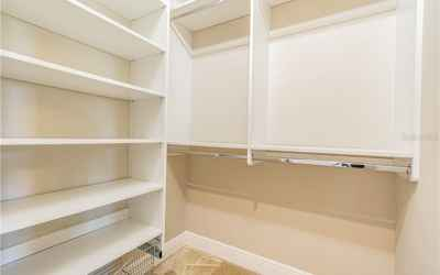 SMALLER CLOSET WITH EUROPEAN BUILT INS.