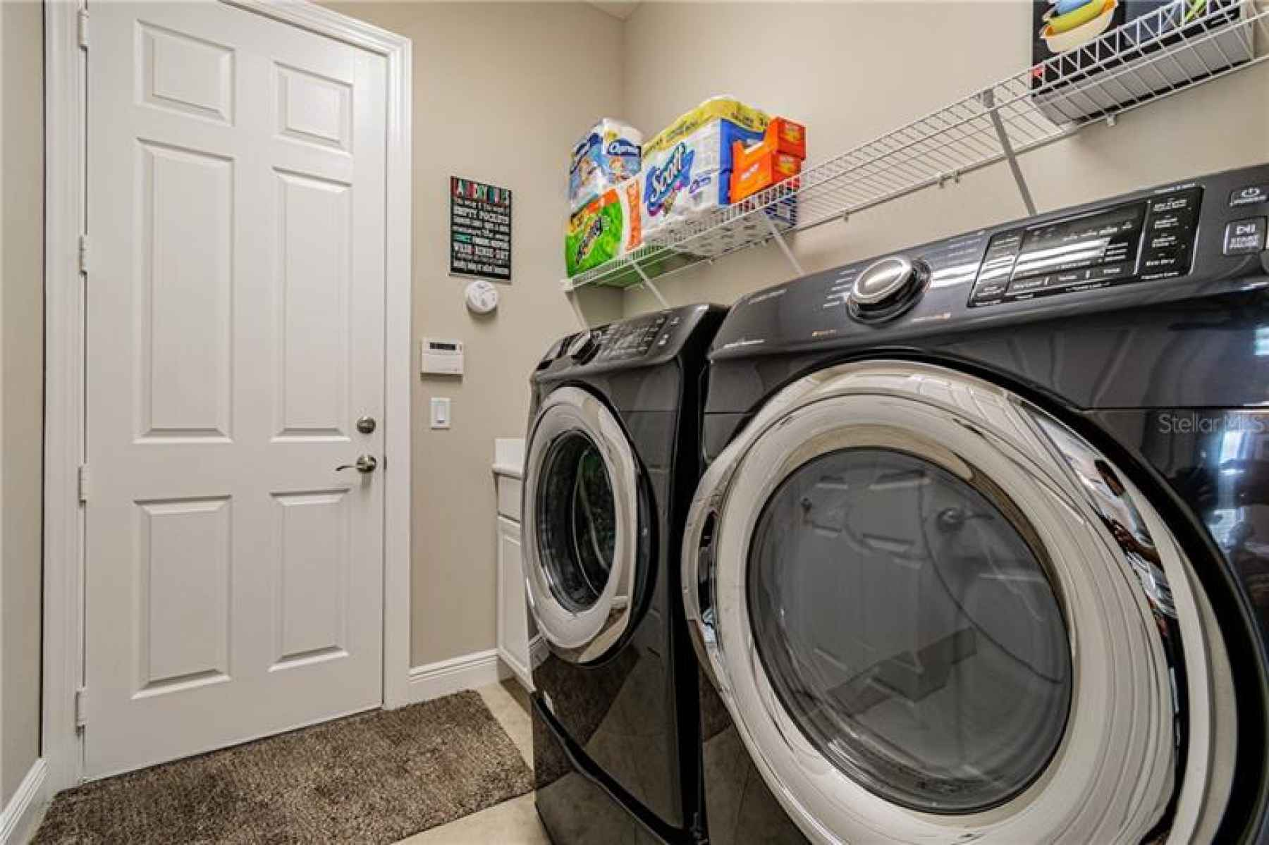LAUNDRY WITH TUB AND UPGRADED WASHER/DRYER