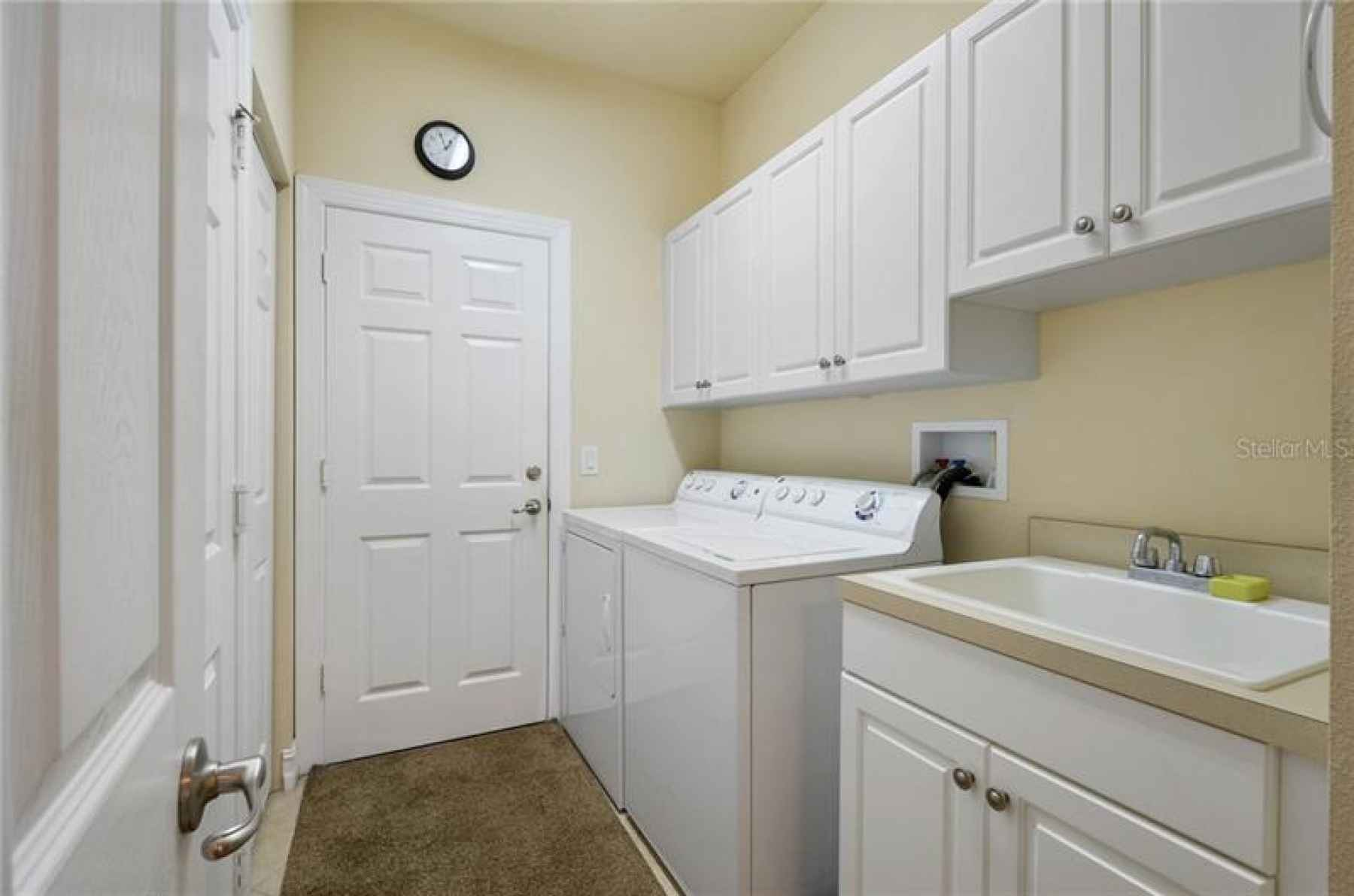Laundry room with washer/dryer and sink!