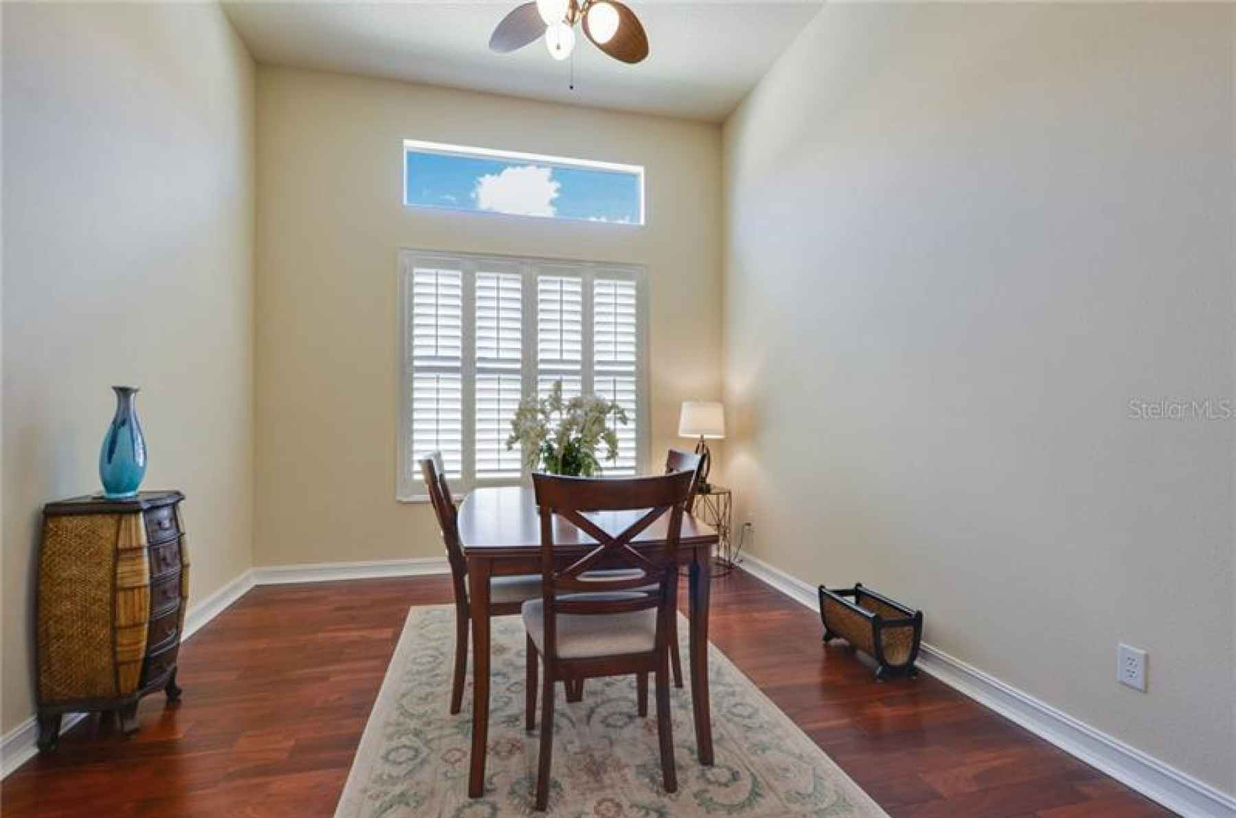 Large dining room with plantation shutters!