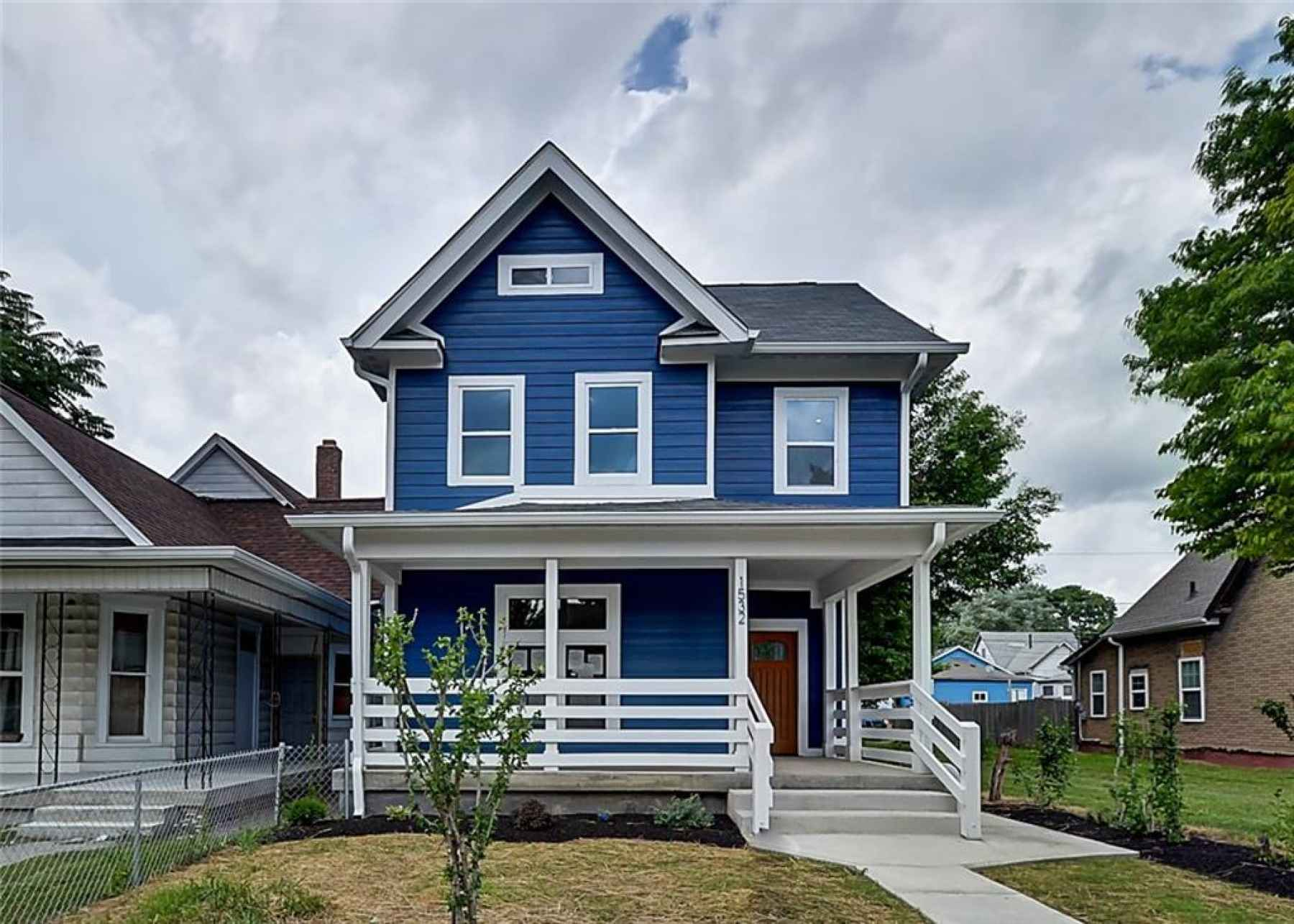 Front of home with wrap-around porch.