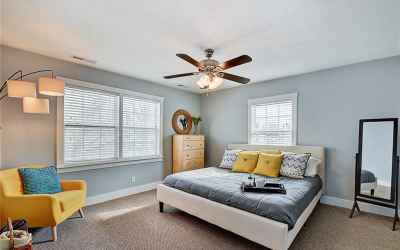 Second floor. Master bedroom. Windows look out onto Park Avenue.