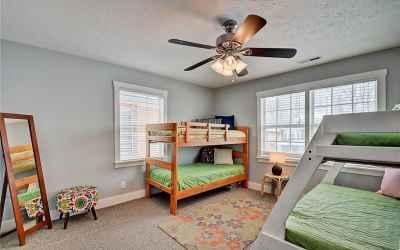 Second floor. Second bedroom located in the northeast corner of home. Windows overlook Park Ave.