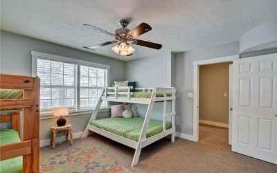 Second floor. Second bedroom located in the northeast corner of home. Windows overlook Park Ave. Doo