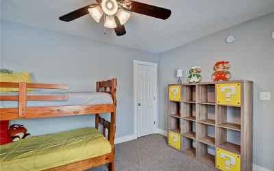 Second floor. Third bedroom located in the northwest corner of the house. Door in the photo is to th