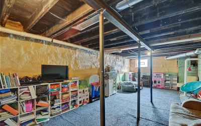 Unfinished basement provides plenty of room for storage or additional space.