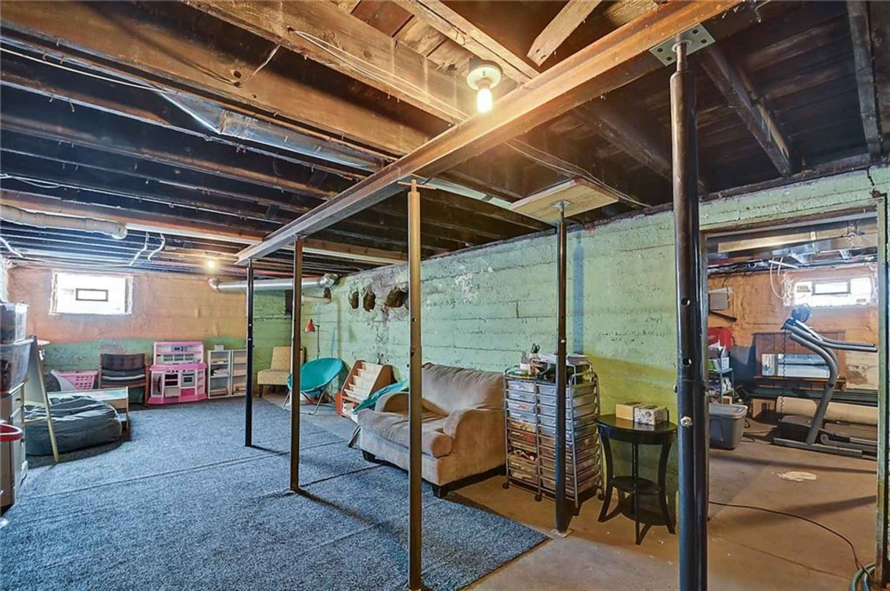 Unfinished basement provides space for storage or other livable space.