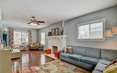 Large, living room from the back of the home. The large window looks out onto Park Ave.