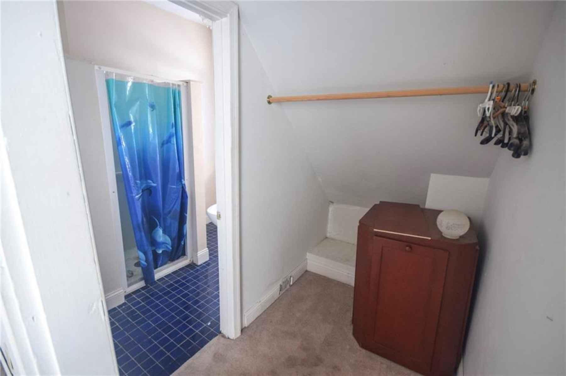 Second floor. Second bedroom w/ full bath.