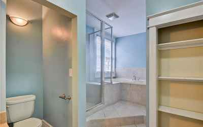 Master bath with toilet room, standing shower with bench and garden tub.