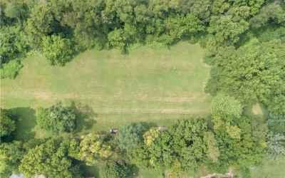 Flat leveled grassy area of lot