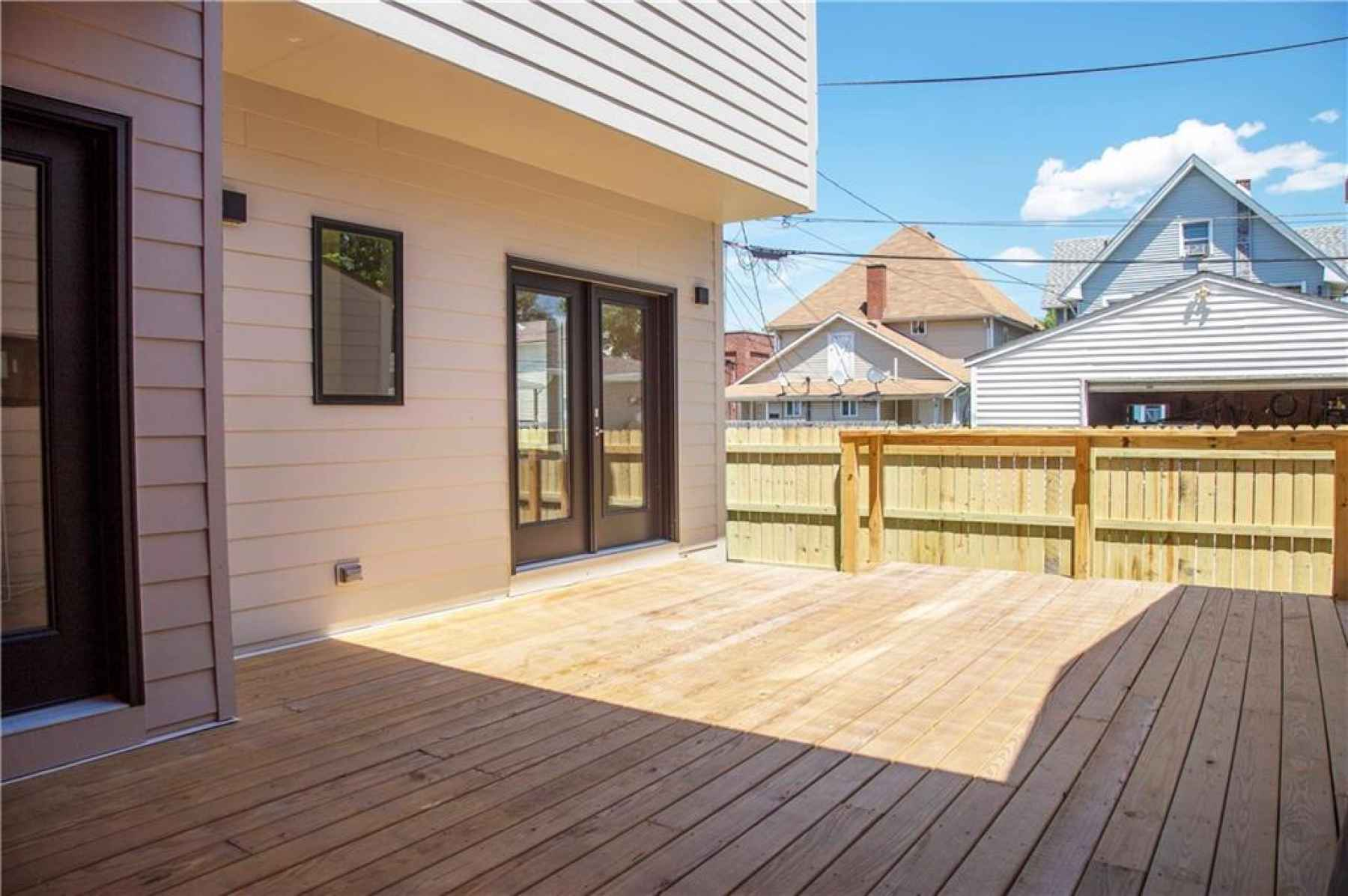 Back deck with privacy fence.