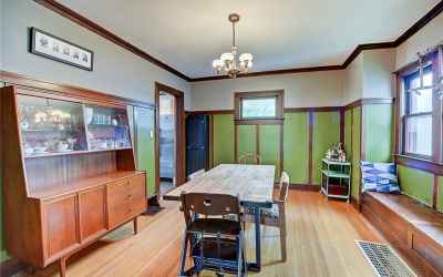 Dining room with lovely window seat. Doorway on the left leads to the kitchen.