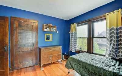 Second floor. Third bedroom. Closet door is in the left of the photo.