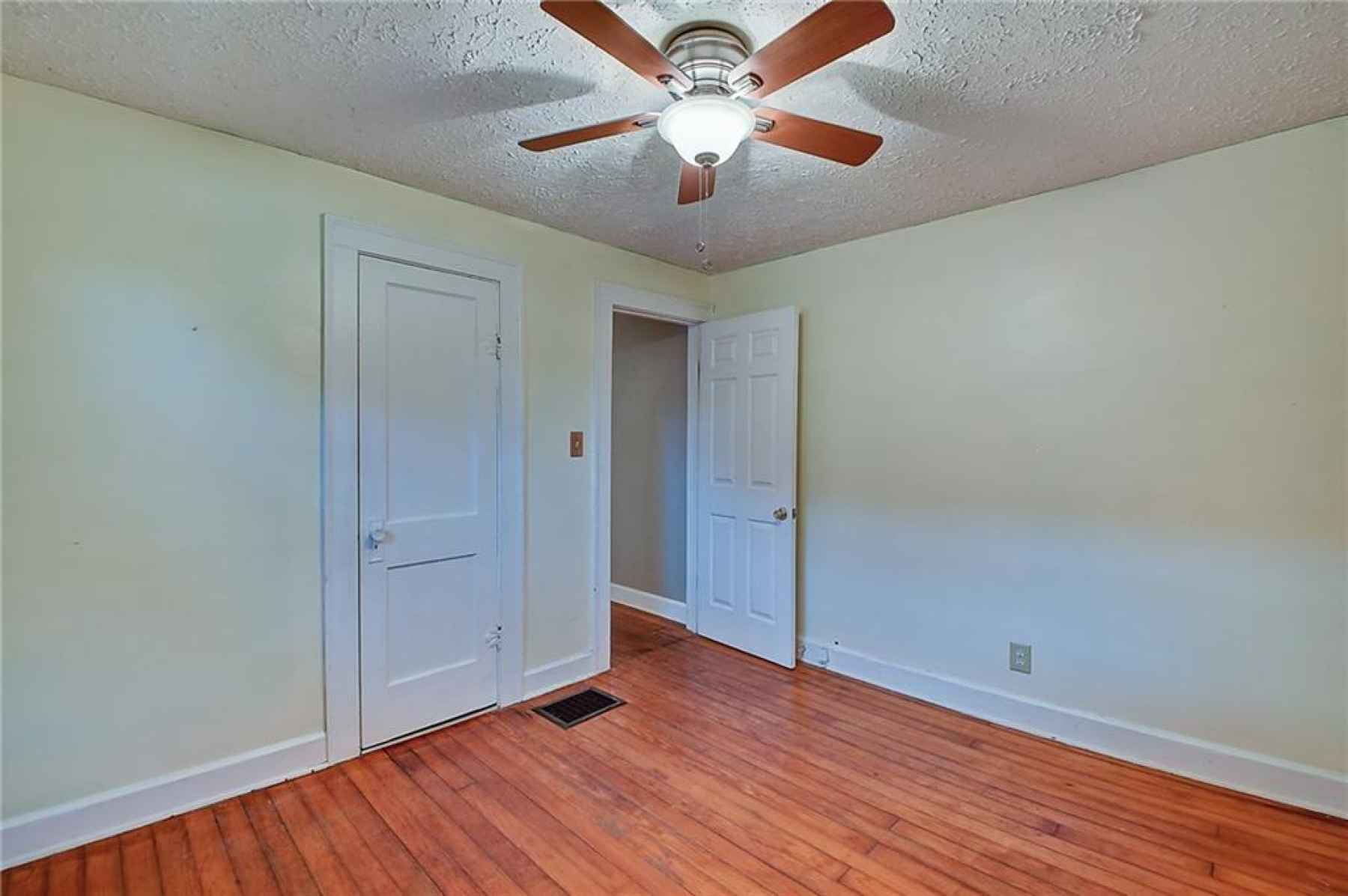 Bedroom on the left of the bathroom. Located at the front of the home.