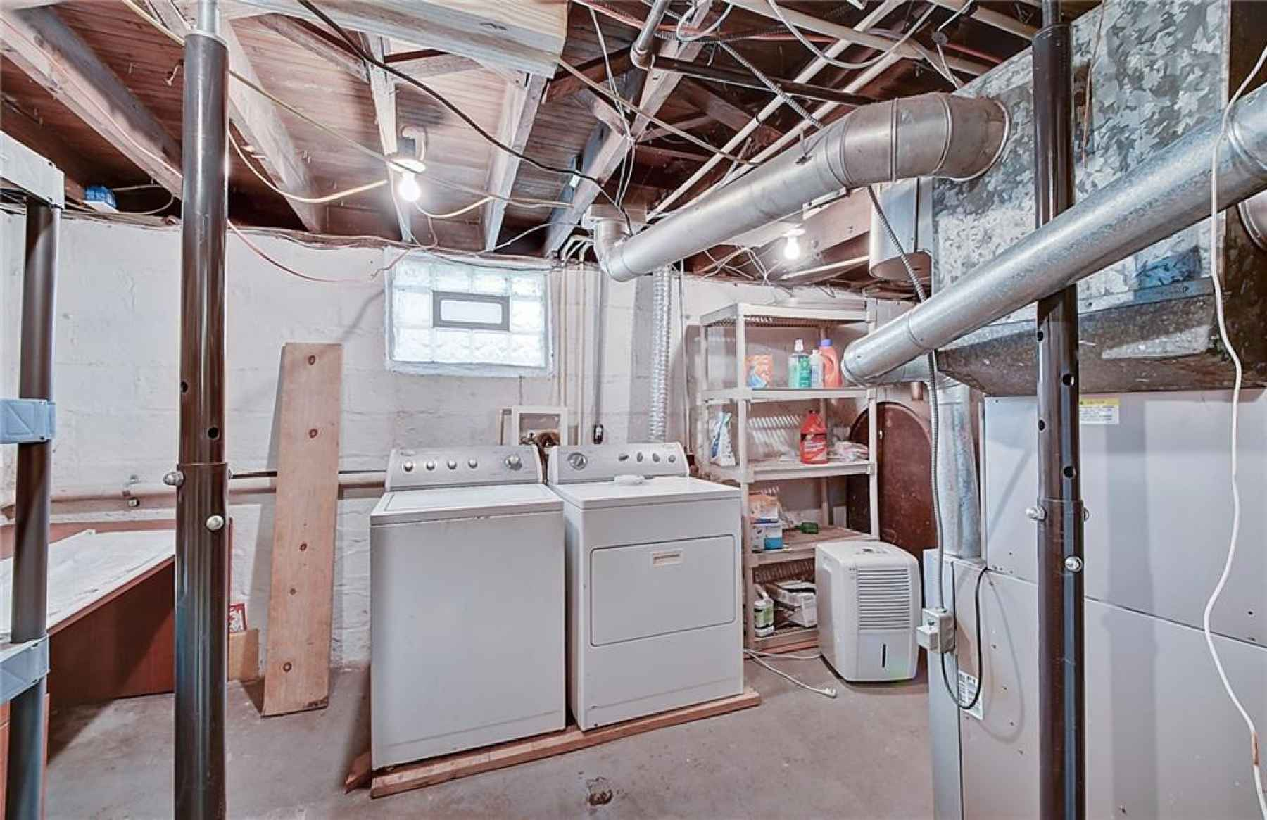 Laundry and storage area in basement.