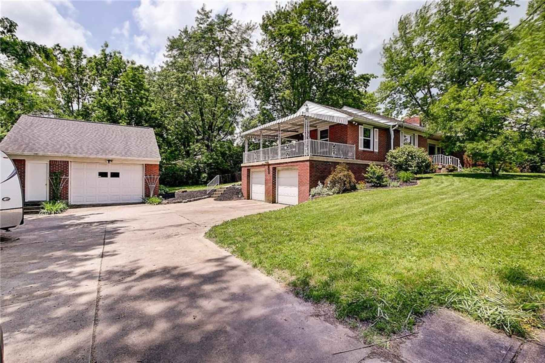 Welcome to 1060 N Edmondson Ave! .99ac lot, 2-car attached garage, heated workshop, huge driveway an