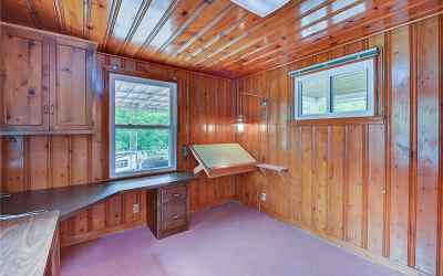 Look no further for this amazing knotty pine office or den!