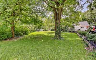 Amazing side yard with creek, woods and mature trees.