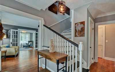 The entry from the main door showcases the beautiful stair and also has a coat closet!