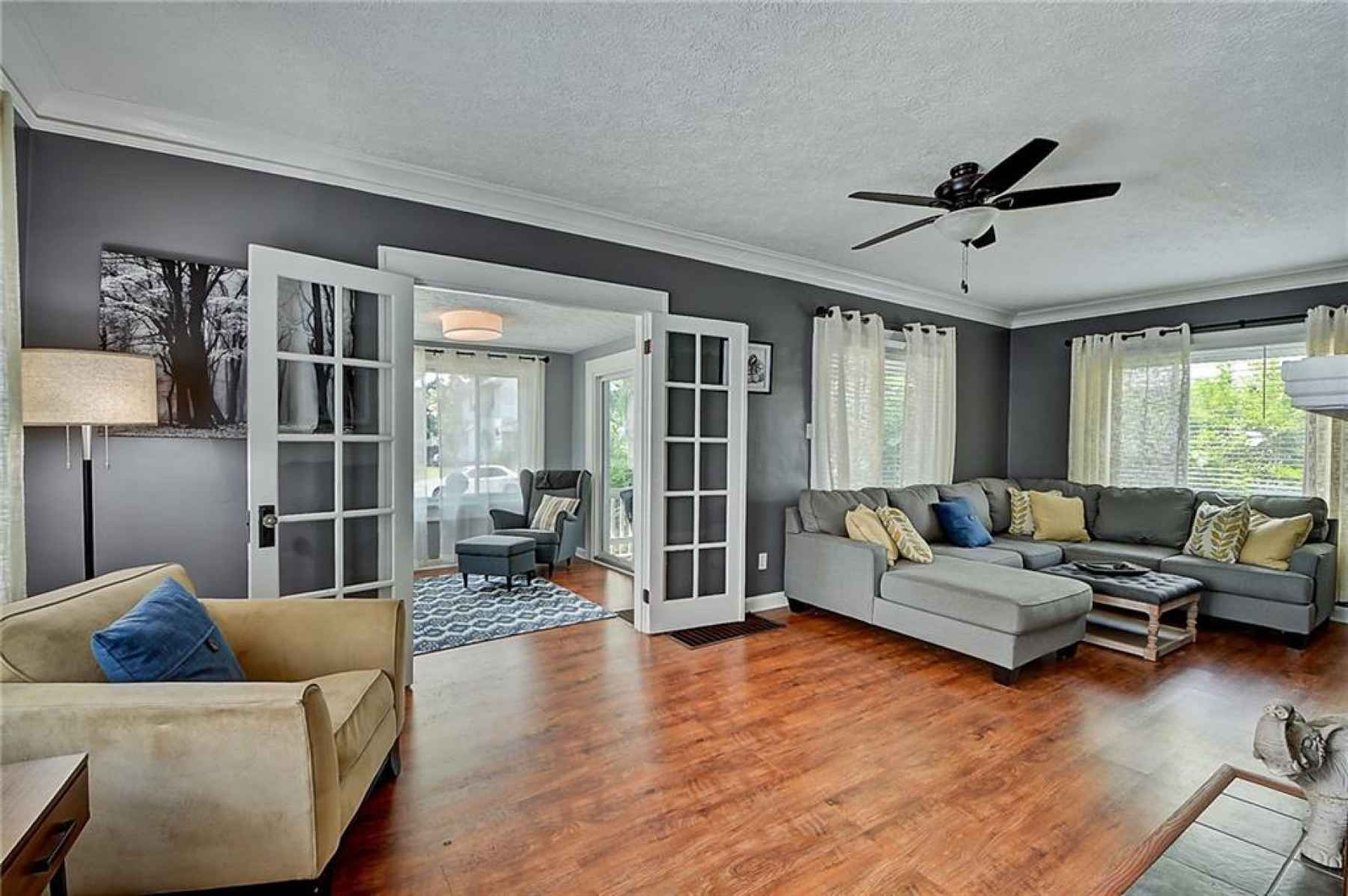 Large living room with a cozy sunroom, perfect as an office, playroom, or plant area!