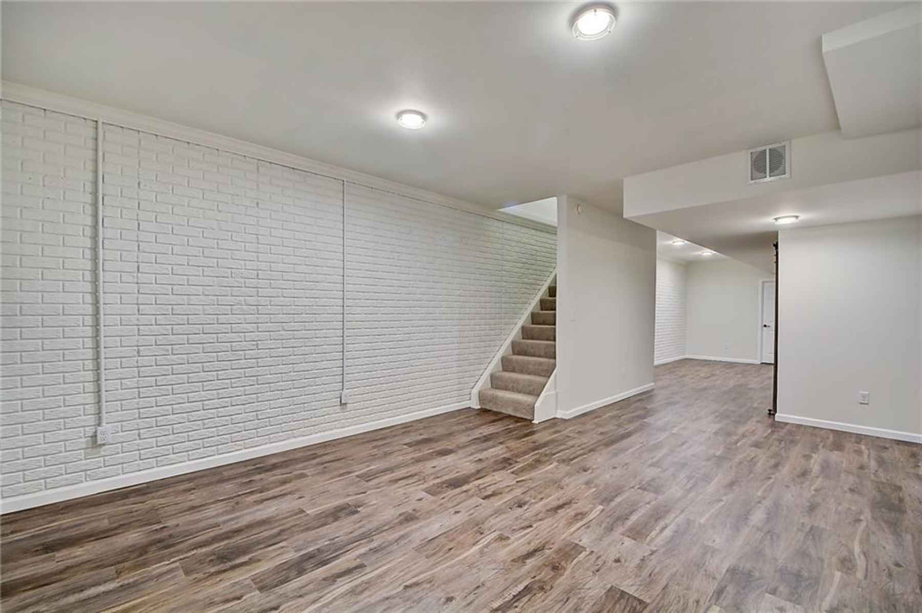 Finished basement with vinyl plank flooring