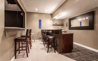 Basement mini kitchen and bar. Theater room to the left.