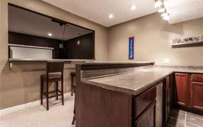Basement mini kitchen and bar. Theater is located through the opening.