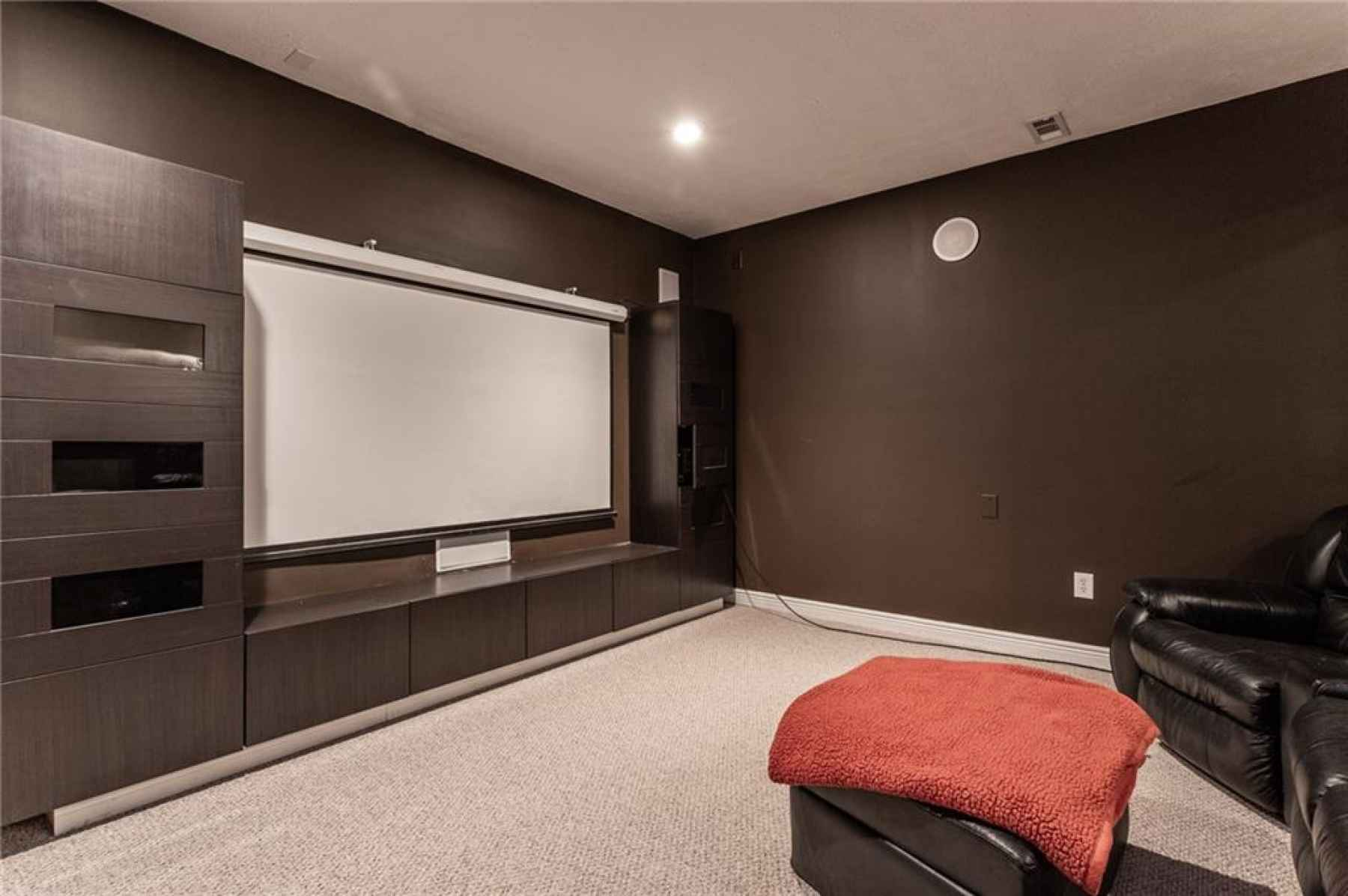 Basement theater room with built-in surround sound.