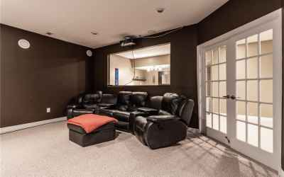 Basement theater room with built-in surround sound. Looking through to the mini kitchen and bar. The