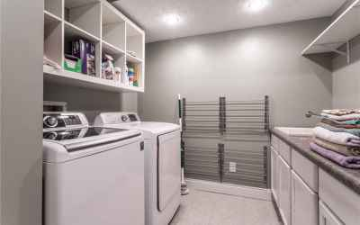 Spacious laundry room in basement.