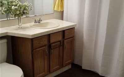 This spacious full bathroom has a ton of closet space!