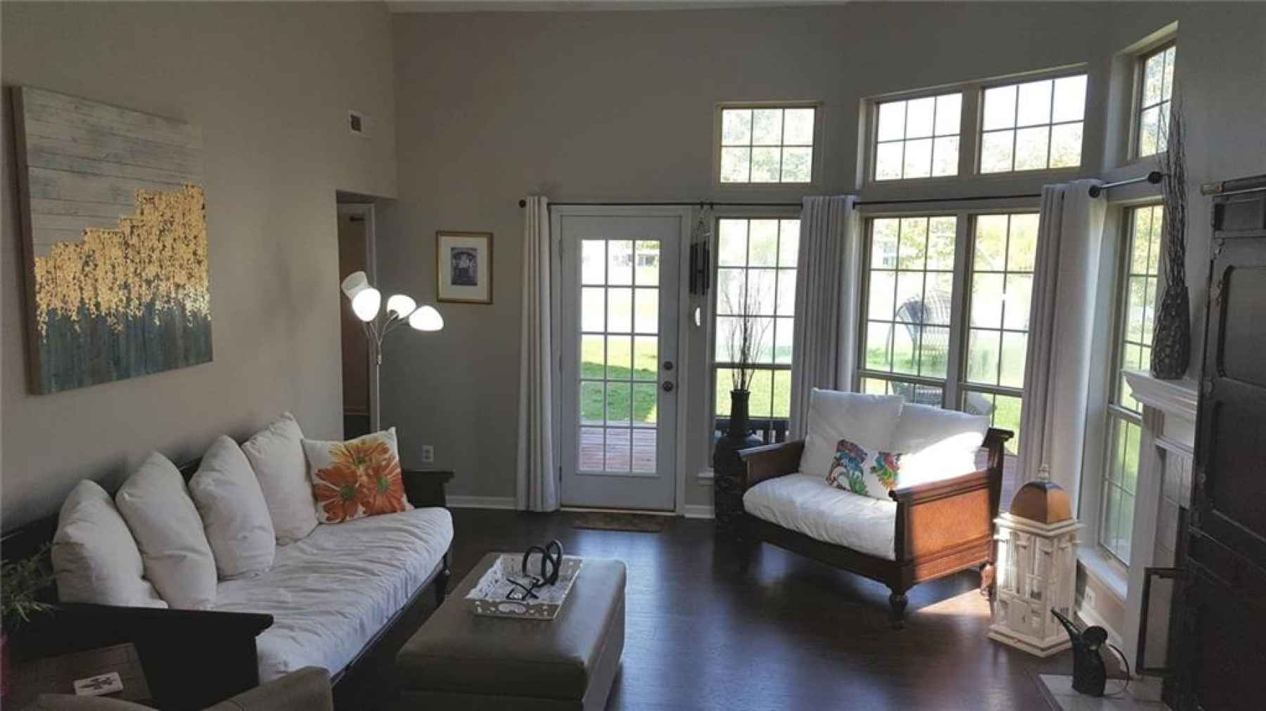 Lakeside living at it's best in this 'light and bright' Family Room with new windows, wood-laminate