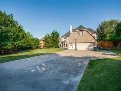 Long driveway to 3 car garage with yard all around!