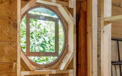 Gorgeous architectural details include 200 year old cast iron porthole windows.