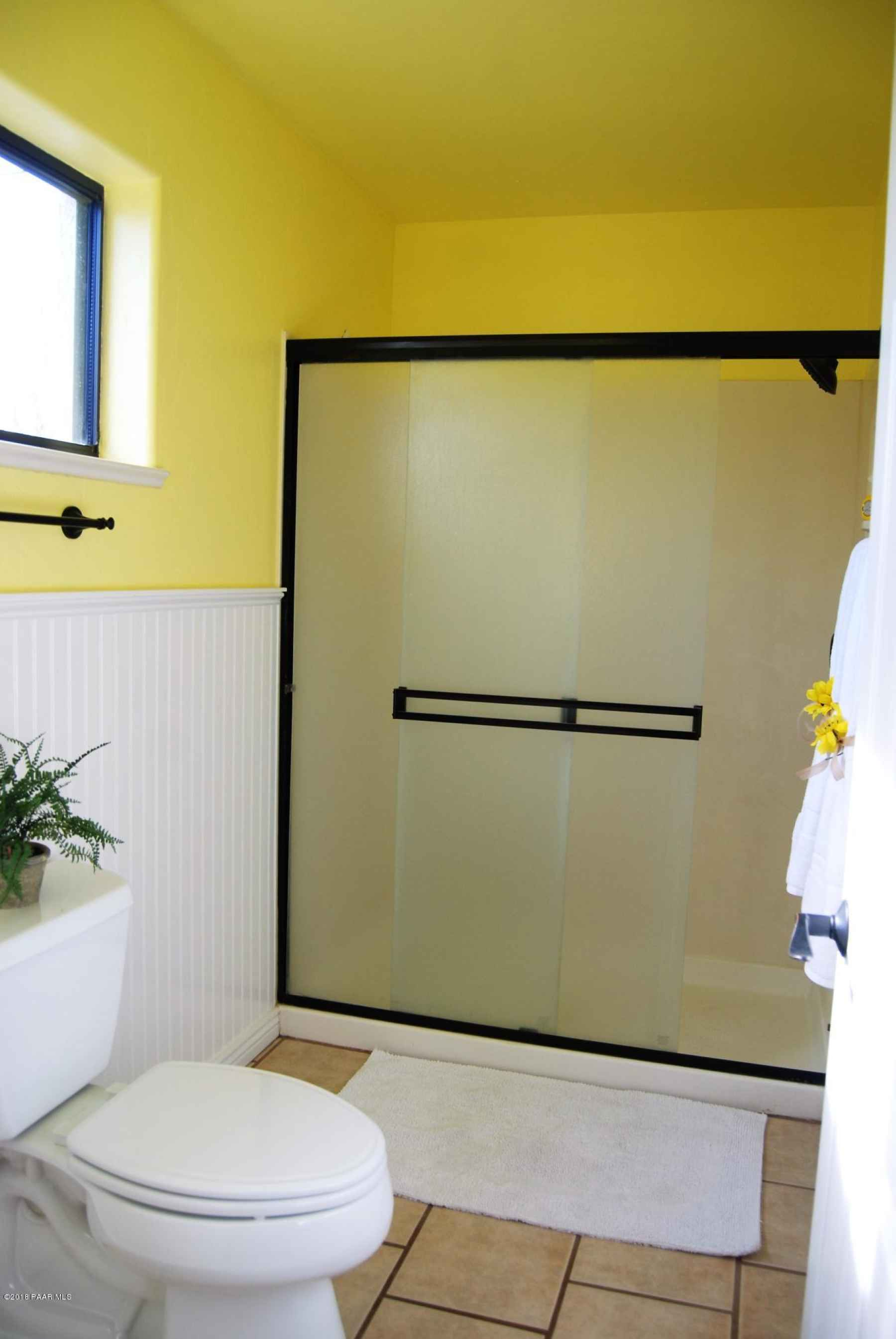 Separate room with toilet and shower in