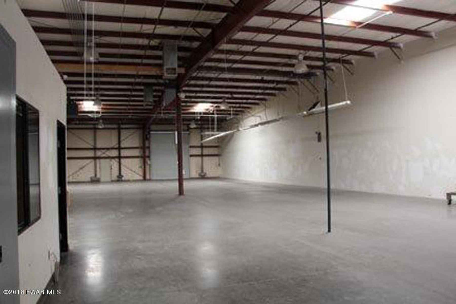 Interior view past office in warehouse s