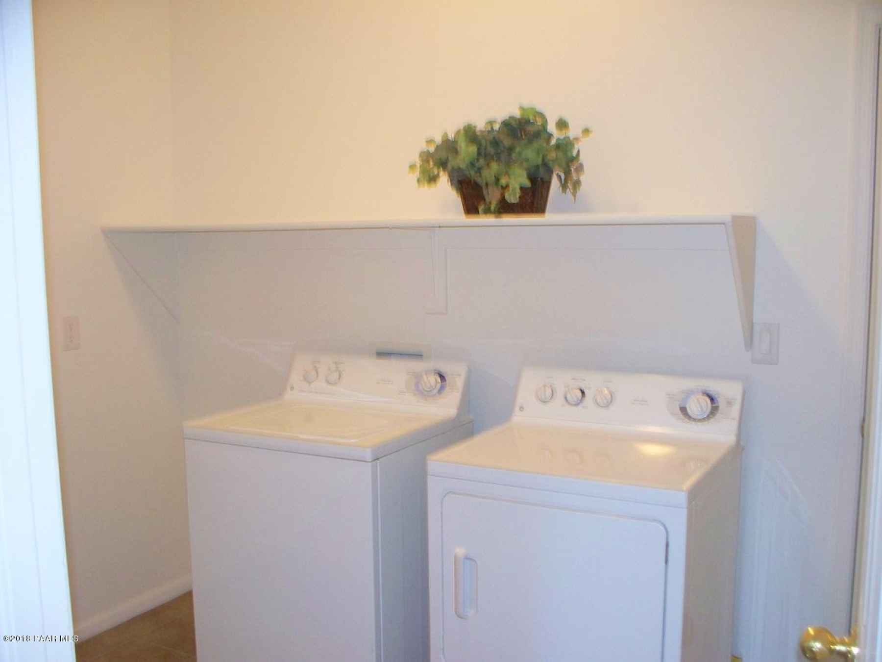 Inside Laundry Room with Washer & Dryer