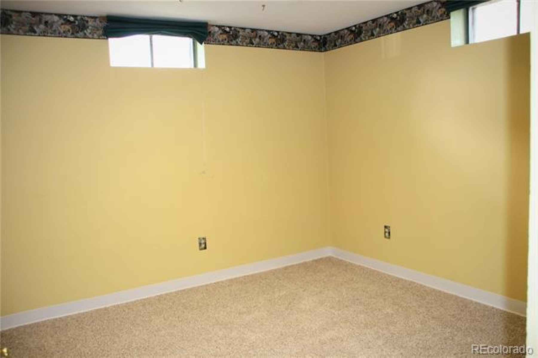 bedroom in basement has large closet, but small windows